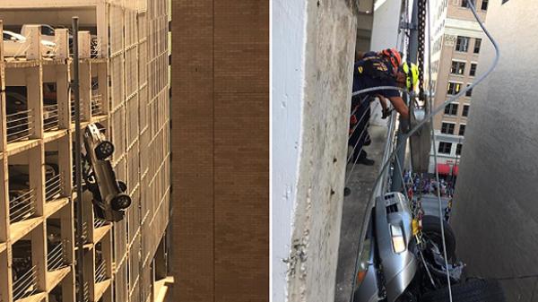 صورة سلك واحد ينقذ سائق سيارة انقلبت وهوت من الطابق التاسع بأميريكا