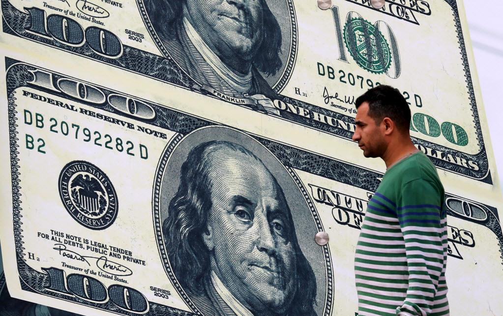 صورة الدولار يتجاوز 18 جنيهاً في تعاملات البنوك الصباحية