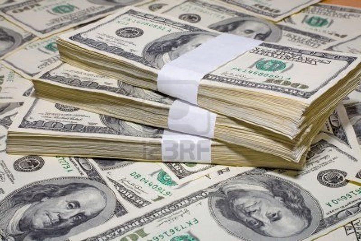 صورة ضبط تاجر عملة بحوزته 115 ألف دولار بمنشأة أبوعمر