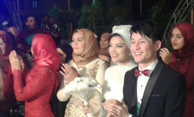 صورة شاب صينى يشهر إسلامه ليتزوج بفتاة مسلمة فى دمياط