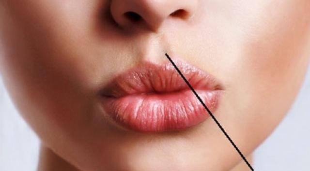 صورة سر الجزء الأجوف الموجود بين أنفك وشفتيك