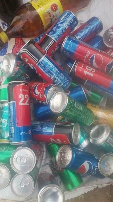 صورة ضبط زجاجات من مشروبات غازية منتهية الصلاحية بأبوكبير