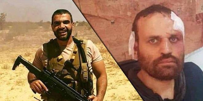 صورة عمرو أديب يعرض صورة للشهيد المنسي والإرهابي عشماوي