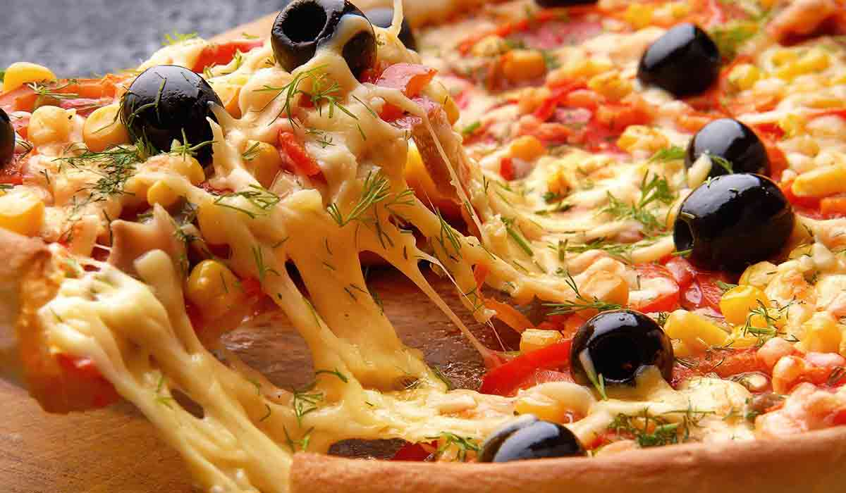Pizza with cheese and olives